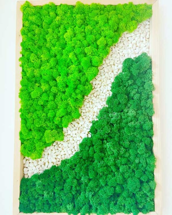 River rock wall art with moss